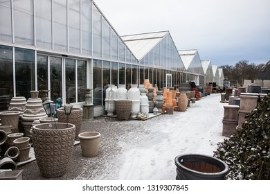 STOCKHOLM, FEBRUARY 2018, greenhouses in a garden center ona cold, winter day with grey skies.