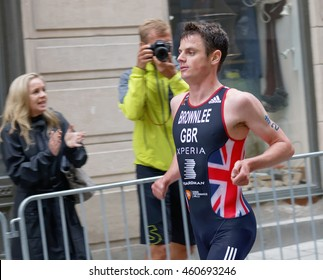 STOCKHOLM - JUL 02, 2016: Side view of running triathlete Jonathan Brownlee in the Men's ITU World Triathlon series event July 02, 2016 in Stockholm, Sweden