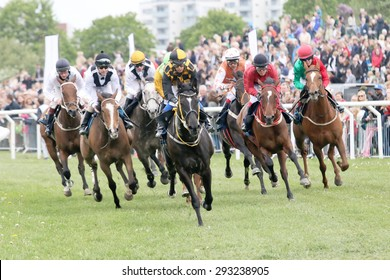 STOCKHOLM - JUNE 06: Tough race between the race horses in the last curve at the Nationaldags Galoppen at Gardet. June 6, 2015 in Stockholm
