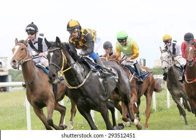 STOCKHOLM - JUNE 06: Tough race between the race horses and jockeys  at the Nationaldags Galoppen at Gardet. June 6, 2015 in Stockholm