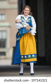 STOCKHOLM - JUNE 6, 2014: Princess Madeleine of Sweden with Princess Leonore in her arms at the opening of the Stockholm Palace for the public. June 6, 2014 in Stockholm, Sweden.