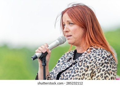 STOCKHOLM - JUNE 6: Shirley Clamp singing the Swedish national anthem before the horse racing competition at Nationaldags Galoppen at Gardet. June 6, 2015 in Stockholm, Sweden.