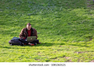 Stockholm May 1:st 2018, a man have moved out from the office to the lawn