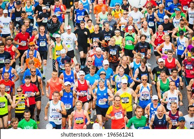 STOCKHOLM - MAY 31: Group of colorful runners in lycra after the start of ASICS Stockholm Marathon 2014. May 31, 2014 in Stockholm, Sweden.