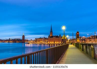 Stockholm night city skyline at Gamla Stan and Slussen, Stockholm Sweden