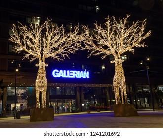 STOCKHOLM - NOV 25, 2018: Gigantic reindeers christmas decoration made of led light in outside Gallerian, Stockholm, Sweden, November 25, 2018