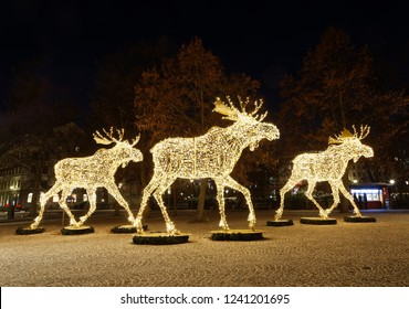 STOCKHOLM - NOV 25, 2018: Gigantic elk or moose christmas decoration made of led light at Nybrokajen, Stockholm, Sweden, November 25, 2018