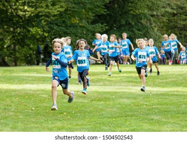 STOCKHOLM - SEPT 08, 2019: Kids running in the nature during the Generation PEP day in Hagaparken, to make kids be more physical active and more healthy. Stockholm,Sweden,September 08, 2019