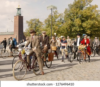 STOCKHOLM - SEPT 22, 2018: Group of people wearing old fashioned tweed clothes waiting to start in the Bike in Tweed event September 22, 2018 in Stockholm, Sweden
