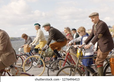 STOCKHOLM - SEPT 22, 2018: Group of people wearing old fashioned tweed clothes cycling in the Bike in Tweed event in the Bike in Tweed event September 22, 2018 in Stockholm, Sweden