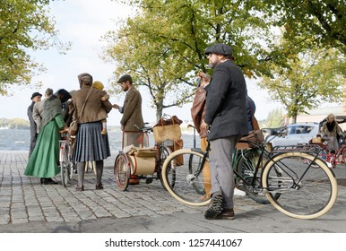 STOCKHOLM - SEPT 22, 2018: People wearing old fashioned tweed clothes from the 1950s leading their retro bicycles in the Bike in Tweed event September 22, 2018 in Stockholm, Sweden
