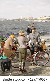 STOCKHOLM - SEPT 22, 2018: People wearing old fashioned tweed clothes and retro bicycles in the Bike in Tweed event September 22, 2018 in Stockholm, Sweden
