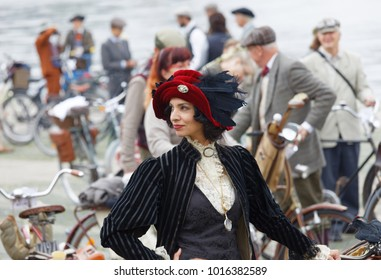 STOCKHOLM - SEPT 23, 2017: Elegant upper class woman dressed in clothes from aprox 1900 and a spectacular hat with feathers in the Bike in Tweed event September 23, 2017 in Stockholm, Sweden