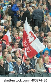 STOCKHOLM - SEPT 24, 2016: Crowd with the flag of Poland cheering at Stockholm FIM Speedway Grand Prix at Friends Arena in Stockholm.