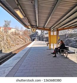 Stockholm, Sweden, 06 april 2019 - Stockholm merto station. Man waiting for a train metro.