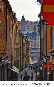 Stockholm, Sweden, 06 april 2019 - People walking on Stockholm old street. Gamla stan. Historical center of Stockholm.