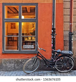 Stockholm, Sweden, 07 april 2019 - Bicycle near traditional stockhom building. old Stockholm streets.