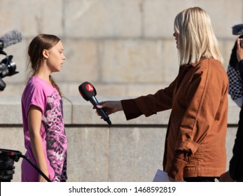 Stockholm, Sweden. 2 August, 2019. 16-year-old Swedish climate activist Greta Thunberg last demonstration in Stockholm on Fridays before going to the US. Being interviewed by Swedish TV4