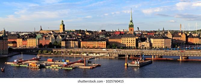 Stockholm / Sweden - 2013/08/01: Old town quarter Gamla Stan with Tyska Kyrkan - XVII century St. Gertrude church and Centralbron bridge
