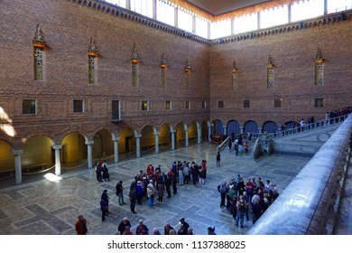 Stockholm, Sweden - 24 June 2018: Stockholm City Hall interior with groups of people