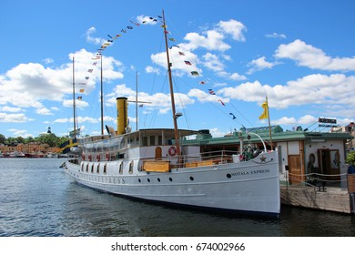 Stockholm, Sweden- 27 Jun 2017:Swedish vintage passenger ship with a smokestack. Retro ship tourist attraction for a sightseeing on the background of old town port and buildings cafe