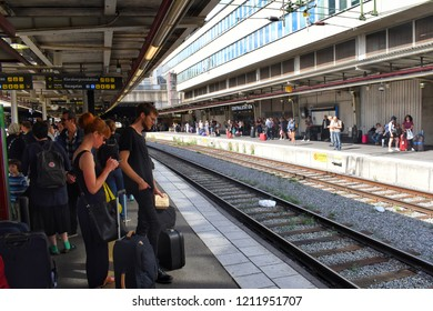 Stockholm, SWEDEN - 28 July, 2017 : A group of people are waiting in front of a train in the Central Station, Stockholm.