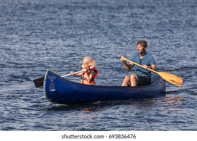 STOCKHOLM SWEDEN 30 July 2017. Man and child paddles a Canadian canoe.