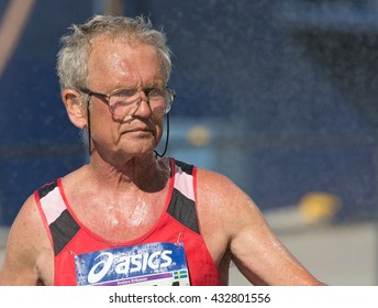STOCKHOLM SWEDEN 4 JUNE 2016.  Stockholm marathon, male athlete in the race, older gentleman cooling off with water.