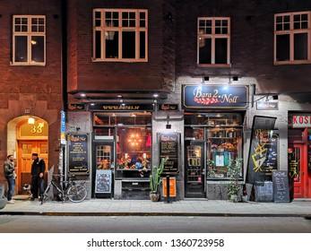 Stockholm, Sweden, 5 April 2019 - Stockholm old street night view. Bar. Restaurant