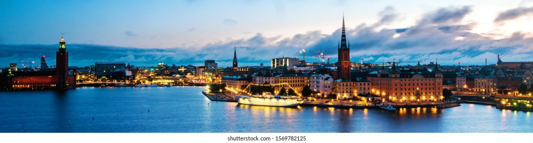Stockholm, Sweden. Aerial view of Gamla Stan in Stockholm, Sweden with landmarks like Riddarholm Church during the sunrise. View of old buildings and cloudy sky in the night