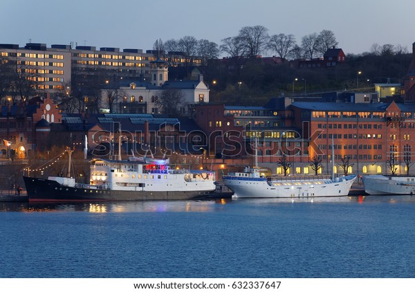 STOCKHOLM, SWEDEN - APR 30, 2017: Boats at the quay in central stockholm in the evening, buildings in the background, April 30, 2017 in Stockholm, Sweden