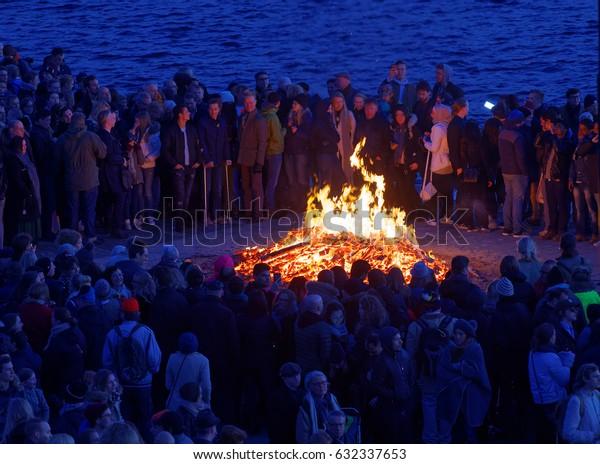 STOCKHOLM, SWEDEN - APR 30, 2017: Celebrating the spring with the Valborg bonfire at Riddarholmen in the evening April 30, 2017 in Stockholm, Sweden