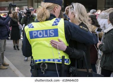 STOCKHOLM, SWEDEN - April 09, 2017:Women hugs a police officer at a peace demonstration in Stockholm