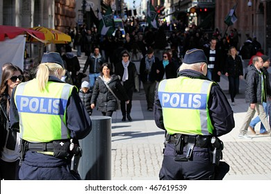 STOCKHOLM, SWEDEN - APRIL 14, 2013: Swedish police and protesters in the street of the capital city