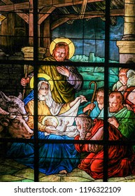 Stockholm, Sweden - April 16, 2010: Stained glass in the German Church in Gamla Stan in Stockholm, depicting the Adoration by the Shepherds (Nativity Scene) at Christmas.