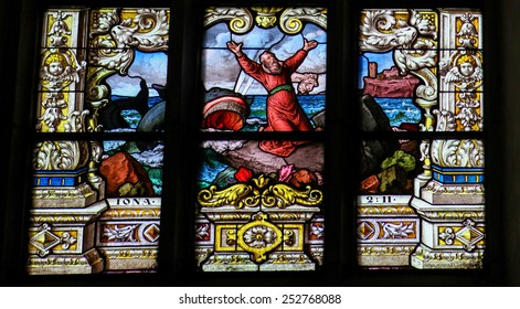 STOCKHOLM, SWEDEN - APRIL 16, 2010:  Stained glass window in Gamla Stan in Stockholm, depicting Jonah and the whale.