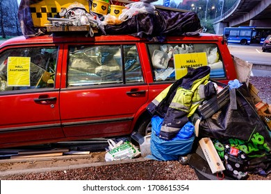 """Stockholm, Sweden April 20, 2020 An impounded car with a sign saying """"Keep your distance"""" in the Ropsten neighborhood."""