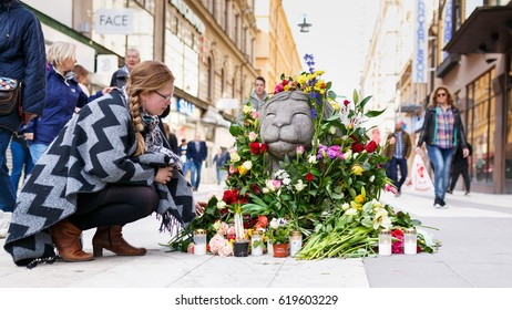 Stockholm, Sweden April 2017 - A girl showing her respect for one of the victims