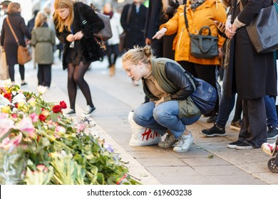 Stockholm, Sweden April 2017 - A girl showing her respect and interest for one of the victims in the terror attack in Stockholm