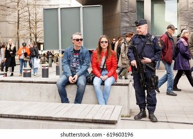 Stockholm, Sweden April 2017 - Heavily armed police man having a chat with two citizens of Stockholm after the terror attack