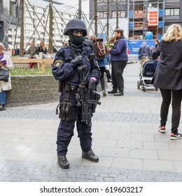 Stockholm, Sweden April 2017 - Masked heavily armed police woman on post after terror attack in Stockholm. Funny detail - her watch is not matching the rest of her equipment.