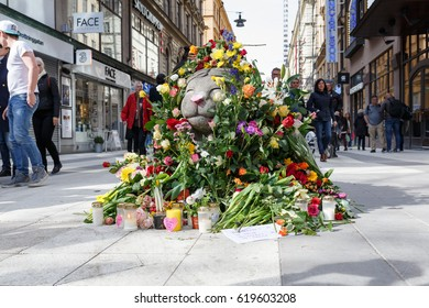 Stockholm, Sweden April 2017 - At the street Drottninggatan, there are road blockers in the shape of lions. These are now covered by flowers to give tribute to the victims of the terror attack