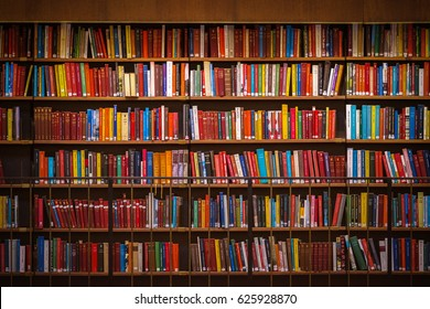 STOCKHOLM, SWEDEN - APRIL 22, 2017: Colorful wall of books on the shelfs at the rotunda in Stockholm Stadsbibliotek or Public Library. The building is from 1928 and the architect is Gunnar Asplund