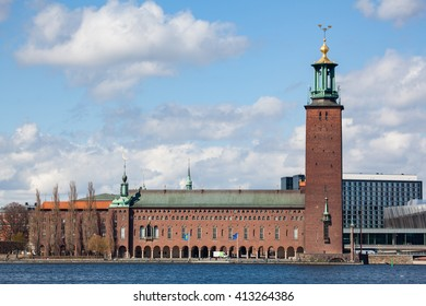 Stockholm, Sweden - April 29, 2016 : Waterfront view Stockholm city hall under a clear spring sky with clouds.