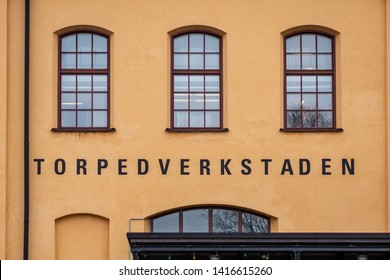STOCKHOLM, SWEDEN - APRIL 6, 2015: Closeup front view of the old army factory building Torpedvekstaden, now a public museum in Stockholm Sweden April 6, 2015.