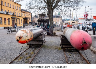 STOCKHOLM, SWEDEN - APRIL 6, 2015: Front view of two old submarine torpedoes outside the museum Torpedverkstaden in Stockholm Sweden April 6, 2015. Incidental people in the background.