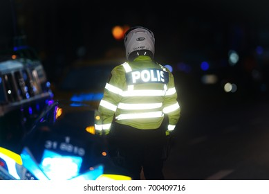 STOCKHOLM, SWEDEN - AUG 19, 2017: Police motorcycle officer at the midnight run or Midnattsloppet at the streets of Stockholm. 10 km