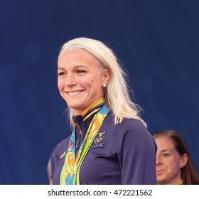 STOCKHOLM, SWEDEN - AUG 21, 2016: Swimmer Sarah Sjostrom showing her medals from the olympic games when the swedish olympic athletes are celebrated in Kungstradgarden, Stockholm,Sweden,August 21,2016