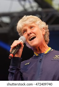 STOCKHOLM, SWEDEN - AUG 21, 2016: Swedish female soccer team captain Pia Sundhage singing when the swedish olympic athletes are celebrated in Kungstradgarden, Stockholm,Sweden,August 21,2016