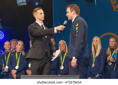 STOCKHOLM, SWEDEN - AUG 21, 2016: Olympic medalists from Rio are celebrated in Kungstradgarden. Minister of health Gabriel Wickstrom